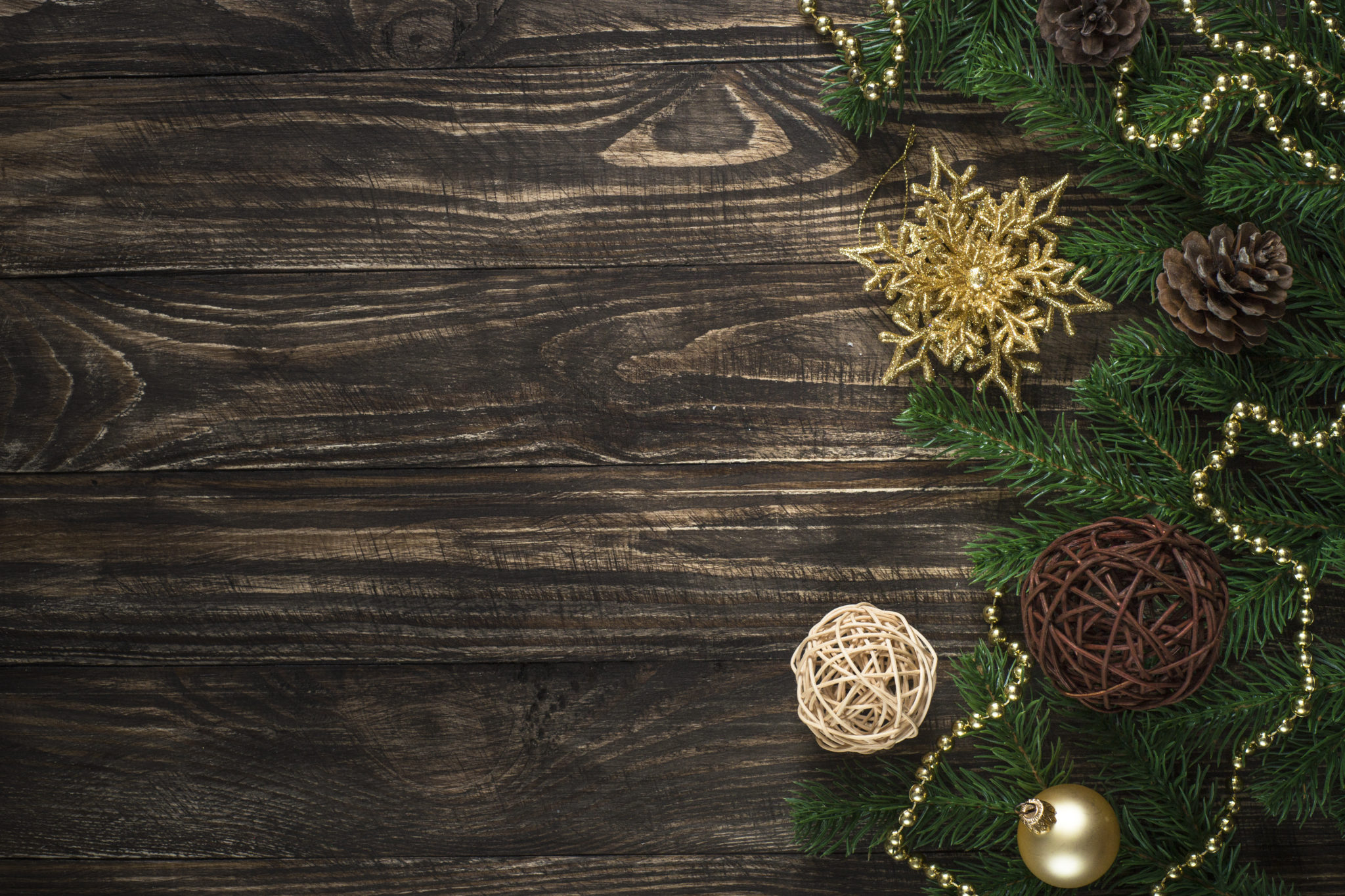 Christmas background with candle and decorations on dark wooden table. Top view with copy space.
